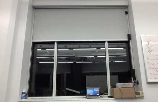 showing a window with a blind that is controlled by a stepper motor and a computer
